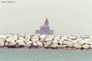Somewhat blurry shot of the lighthouse out in the lake.