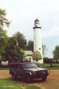 My Jeep Cherokee in front of the lighthouse.
