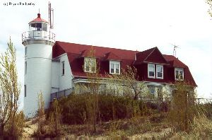 Beautiful close up of the lighthouse tower and quarters.