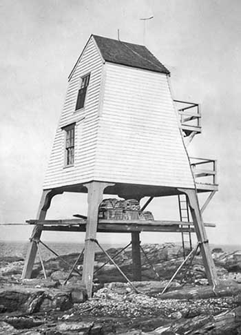 U.S. Coast Guard Archive Photo showing the raised oil house at Halfway Rock Lighthouse