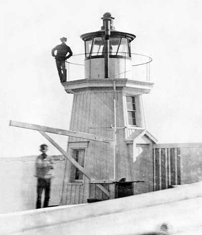 U.S. Coast Guard Archive Photo showing the 1855 wooden Portland Breakwater Lighthouse