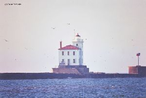 Distance shot of lighthouse on breakwater.