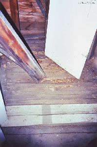 Some of the floorboards are in bad shape.