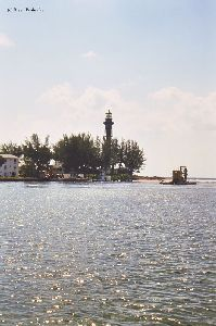 Lighthouse with water in the foreground.