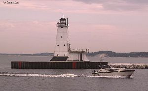 Beautiful shot of the Ludington Pier lighthouse.
