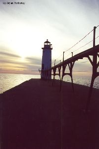 The lighthouse and the pier at dusk.