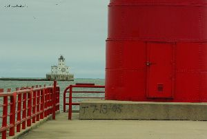 The Pierhead lighthouse keeps a watchful eye over the Breakwater light.