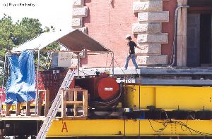 DURING MOVE: A worker walks out from the tower towards the control station.