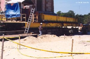 DURING MOVE: A worker getting ready to go beneath the tower.