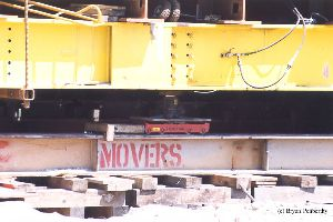 DURING MOVE: Rollers used to move the tower. It