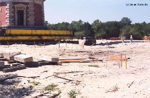 DURING MOVE: Some of the original foundation bricks in the foreground.