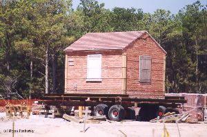 DURING MOVE: The oil house was put on a trailer to be moved.
