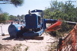 DURING MOVE: Water pump to keep sea water out of the hole.