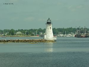 The lighthouse and fishing boats.