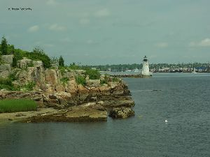 A rocky bluff and the lighthouse.