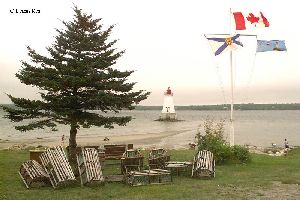 Flags fly by the Sandy Point Lighthouse.