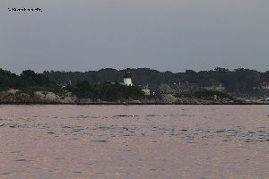 The Ten Pound Island Lighthouse at sunset.