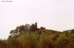 The lighthouse up on the hill.