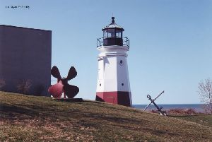 Lighthouse with propeller and anchor.