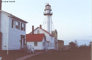 Several buildings and the lighthouse.
